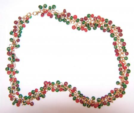 Carnival Necklace: Beads made with red and green spectrum waterglass. The beads are 5 and 6mm in size and the links are made with 0.8mm 20 gauge gold-plated hobby wire. I had to make just under 300 jump rings and 200 small beads.