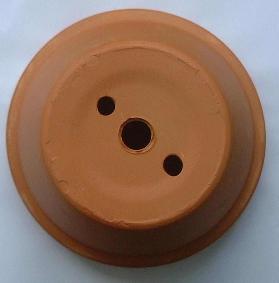Three holed pot